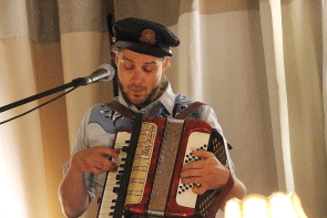 Benj Rowlands playing accordion with The Mayhemingways at the Owl Acoustic Lounge, July 10 Photo by Richard Amery