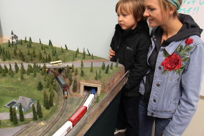 Paige Hudson and her son Riggs looking a the Southern Alberta Model Railway Club's N scale exhibit during their open house, Oct. 21 and 22. Photo by Richard Amery